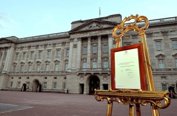 A notice formally announcing the birth of a son to Prince William and Catherine, Duchess of Cambridge, is placed in the forecourt of Buckingham Palace.